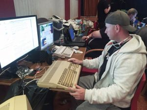 My friend Roger enjoys his Amiga 500 at a demoparty in 2017.